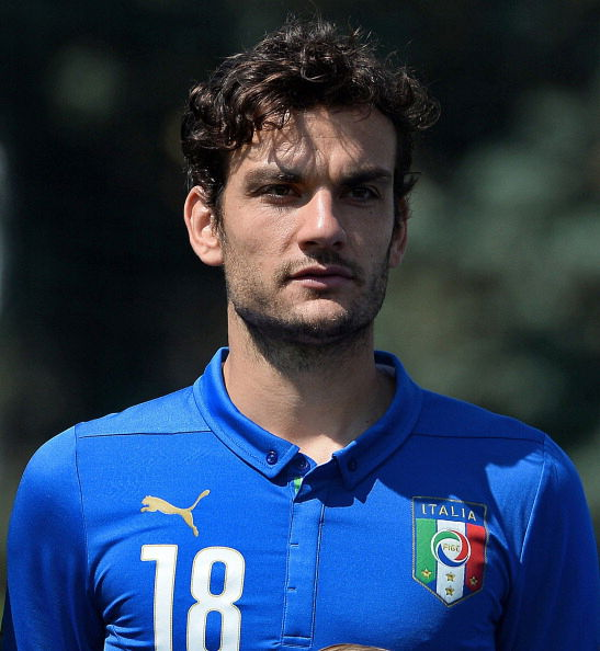 Italy's national football team midfielder Marco Parolo poses for a team picture at Florence's Coverciano training ground on June 3, 2014 ahead of friendly matches for the upcoming FIFA World Cup in Brazil.   AFP PHOTO / FILIPPO MONTEFORTE        (Photo credit should read FILIPPO MONTEFORTE/AFP/Getty Images)
