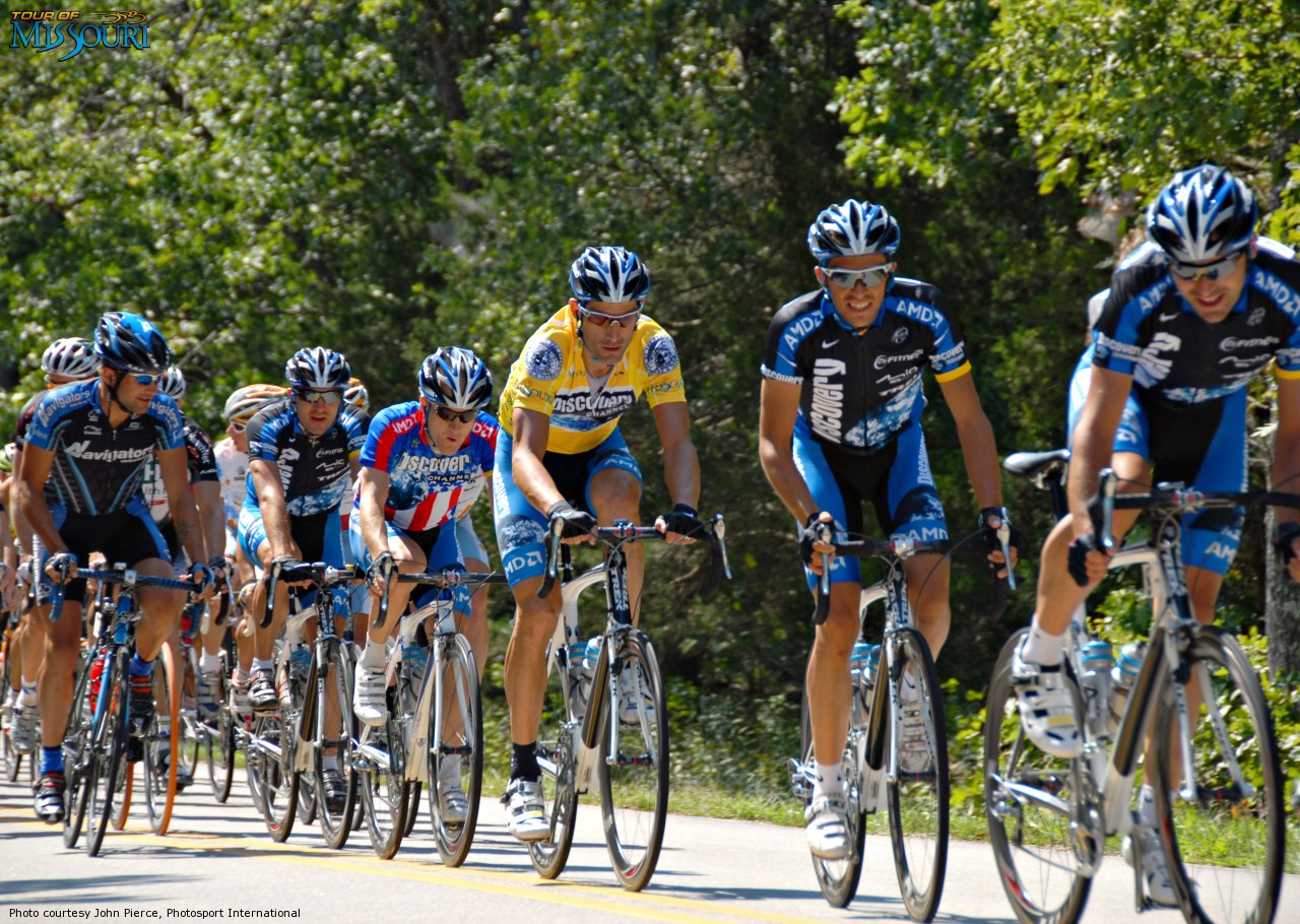 In this this photo provided by PhotoSport International Discovery Channel 'escort' race leader George Hincapie, and National Champion Leipheimer, Tour winner Contador in 2nd place.